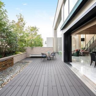 エクレクティックスタイルのおしゃれなテラス・中庭 (オーニング・日よけ、噴水) の写真