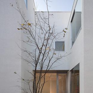 他の地域, のモダンスタイルのおしゃれな中庭のテラス (砂利舗装) の写真