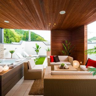 他の地域のコンテンポラリースタイルのおしゃれなテラス・中庭 (張り出し屋根) の写真
