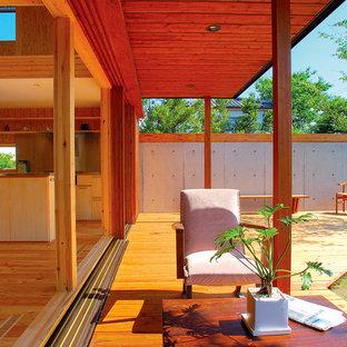 Ispirazione per un patio o portico etnico