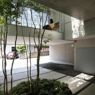 他の地域の中サイズのアジアンスタイルの中庭の画像 (コンクリート敷き、日よけなし)