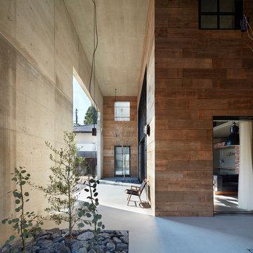 素材を感じるアウトドアコンクリートハウス