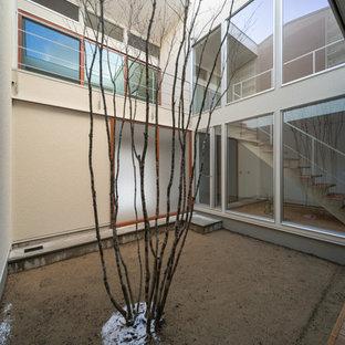 Idee per un patio o portico nordico in cortile con graniglia di granito e nessuna copertura