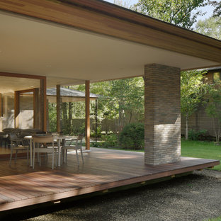 Design ideas for a scandinavian side yard patio in Other with decking and a roof extension.