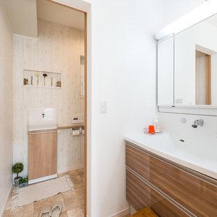 福岡の北欧スタイルのおしゃれなトイレ・洗面所 (フラットパネル扉のキャビネット、中間色木目調キャビネット、白い壁、一体型シンク、茶色い床) の写真