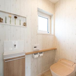 福岡の北欧スタイルのおしゃれなトイレ・洗面所 (ベージュの壁、ペデスタルシンク、ベージュの床) の写真