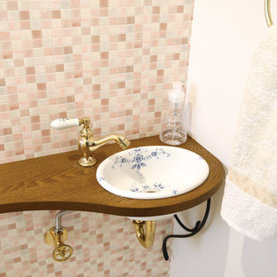 Country cloakroom in Other with open cabinets, white cabinets, multi-coloured tiles, porcelain tiles, multi-coloured walls, vinyl flooring, a built-in sink, wooden worktops, beige floors and white worktops.