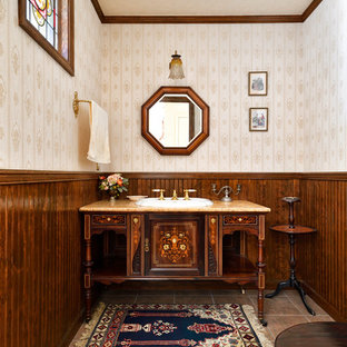 Inspiration for a large traditional cloakroom in Tokyo Suburbs with freestanding cabinets, dark wood cabinets, a two-piece toilet, beige walls, porcelain flooring, a built-in sink, onyx worktops, pink floors and orange worktops.