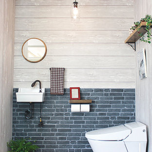 Design ideas for a small industrial cloakroom in Other with blue walls, plywood flooring, a wall-mounted sink, brown floors and white worktops.