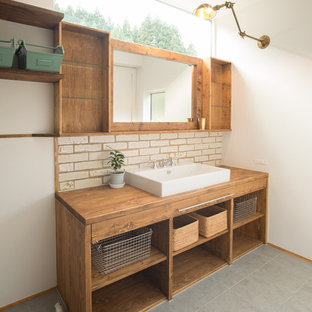 Inspiration for a zen white tile and ceramic tile ceramic floor powder room remodel in Tokyo Suburbs with flat-panel cabinets, medium tone wood cabinets, white walls, wood countertops, a vessel sink and brown countertops