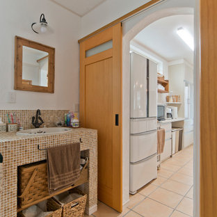 This is an example of a rural cloakroom in Other with multi-coloured tiles, stone tiles, white walls, terracotta flooring, orange floors and multi-coloured worktops.