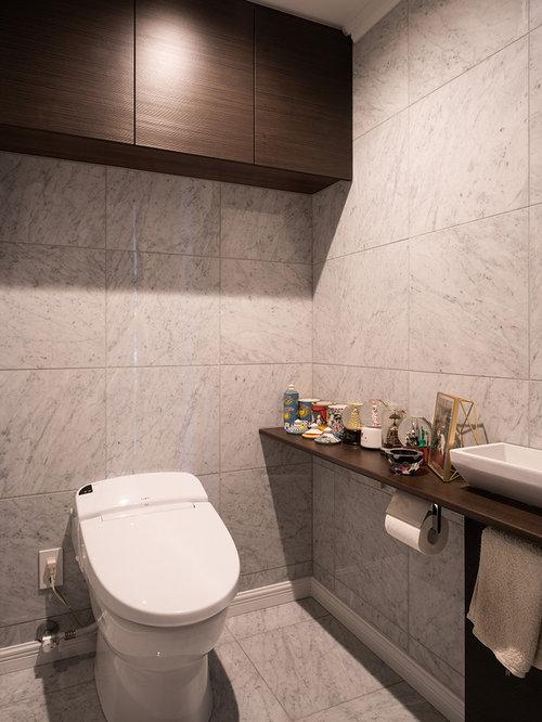 Foto e idee per bagni moderni con piastrelle di marmo - Piastrelle grigie bagno ...