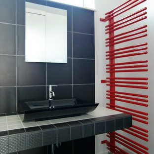 Design ideas for a modern cloakroom in Other with a vessel sink, tiled worktops, black floors, black tiles, porcelain tiles, white walls and plywood flooring.