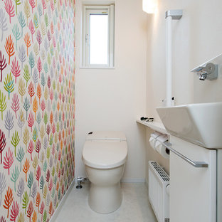 Design ideas for a scandinavian cloakroom in Sapporo with flat-panel cabinets, white cabinets, a one-piece toilet, white walls and white floors.