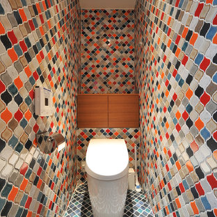 Mediterranean cloakroom in Tokyo with multi-coloured tiles, porcelain tiles, multi-coloured walls and multi-coloured floors.