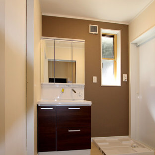 Small modern cloakroom in Other with dark wood cabinets, beige walls, plywood flooring, an integrated sink and white floors.