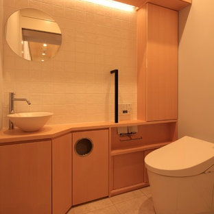 This is an example of a small world-inspired cloakroom in Tokyo with freestanding cabinets, brown cabinets, a one-piece toilet, multi-coloured tiles, porcelain tiles, white walls, porcelain flooring, an integrated sink, solid surface worktops and grey floors.