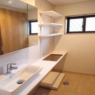 Foto di un piccolo bagno di servizio nordico con ante bianche, piastrelle bianche, piastrelle a mosaico, pareti bianche, pavimento in terracotta, pavimento beige, top bianco, mobile bagno sospeso, soffitto in carta da parati e carta da parati