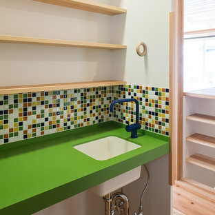 Inspiration for a world-inspired cloakroom in Tokyo Suburbs with open cabinets, light wood cabinets, multi-coloured tiles, mosaic tiles, white walls, light hardwood flooring, a submerged sink, beige floors and green worktops.