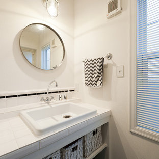 Design ideas for a traditional powder room in Other.