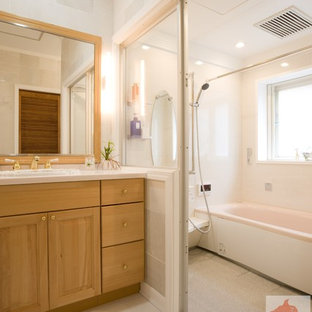 This is an example of a large classic cloakroom in Tokyo Suburbs with recessed-panel cabinets, medium wood cabinets, white tiles, porcelain tiles, white walls, porcelain flooring, a vessel sink, solid surface worktops and white floors.