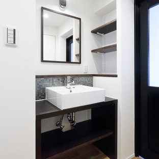 Inspiration for a small scandinavian cloakroom in Tokyo with open cabinets, dark wood cabinets, multi-coloured tiles, mosaic tiles, white walls, light hardwood flooring, a vessel sink, wooden worktops, brown floors and brown worktops.