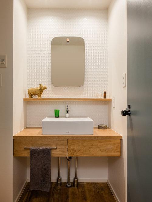 Foto e Idee per Bagni di Servizio - bagno di servizio con ante marroni