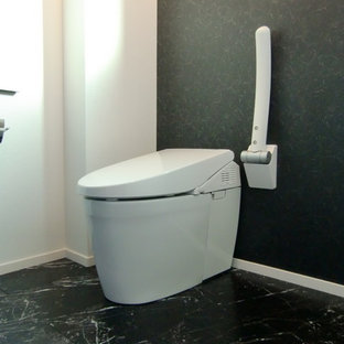 Design ideas for a modern cloakroom in Other with a one-piece toilet, plywood flooring and black floors.