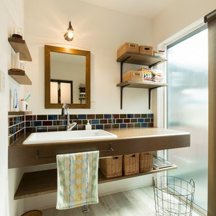 World-inspired cloakroom in Other with open cabinets, a built-in sink and grey floors.