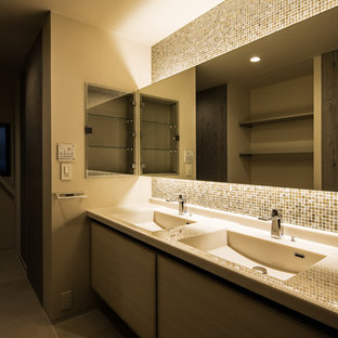 Inspiration for a medium sized modern cloakroom in Osaka with flat-panel cabinets, grey tiles, mosaic tiles, white walls, slate flooring and an integrated sink.