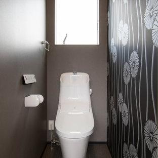 他の地域のモダンスタイルのおしゃれなトイレ・洗面所 (グレーの床) の写真