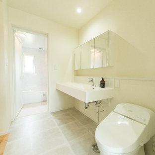 福岡の北欧スタイルのおしゃれなトイレ・洗面所 (白い壁、コンソール型シンク、グレーの床) の写真