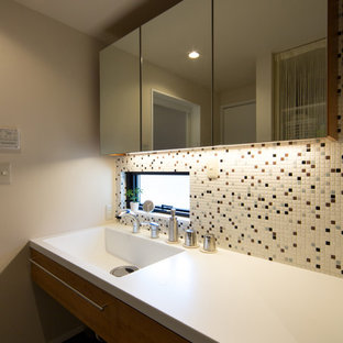 Design ideas for a midcentury cloakroom in Tokyo with multi-coloured tiles, white walls and an integrated sink.