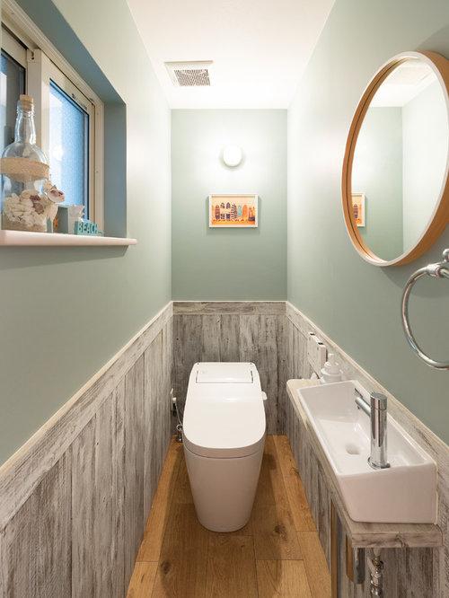 Photo Of A Small Coastal Cloakroom In Kyoto With Blue Walls, Medium  Hardwood Flooring,