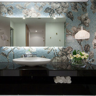 This is an example of a contemporary cloakroom in Other with multi-coloured walls, a vessel sink, brown tiles, beige tiles, blue tiles, multi-coloured tiles and mosaic tiles.