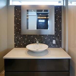 Photo of a modern cloakroom in Other with freestanding cabinets, dark wood cabinets, multi-coloured tiles, mosaic tiles, white walls, vinyl flooring, tiled worktops, beige floors and white worktops.