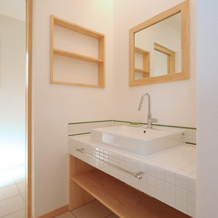 Photo of a world-inspired cloakroom in Other with open cabinets, medium wood cabinets, white tiles, white walls, a vessel sink, tiled worktops, purple floors and white worktops.