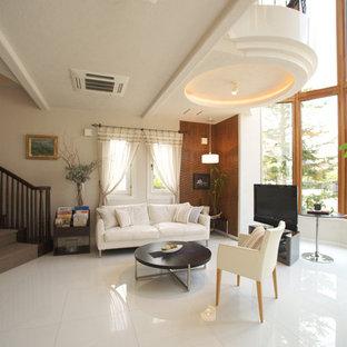 横浜のトラディショナルスタイルのおしゃれなファミリールーム (白い壁、大理石の床、据え置き型テレビ、白い床) の写真