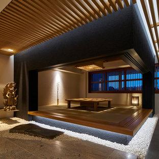Esempio di un soggiorno etnico di medie dimensioni con nessuna TV e pavimento in tatami