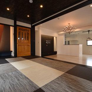 Ispirazione per un soggiorno moderno con pareti bianche, pavimento in tatami, nessun camino e pavimento nero