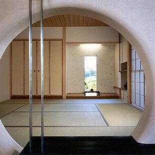 東京都下のアジアンスタイルのおしゃれなファミリールーム (畳) の写真