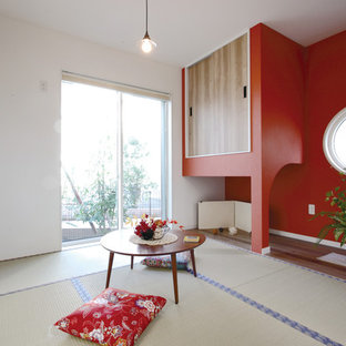 Family room - zen loft-style tatami floor and green floor family room idea in Other with multicolored walls