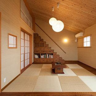 京都のアジアンスタイルのおしゃれなファミリールーム (ベージュの壁、畳) の写真