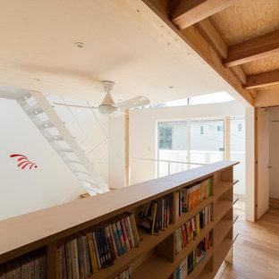 Family room library - shabby-chic style enclosed medium tone wood floor and brown floor family room library idea in Tokyo Suburbs with white walls