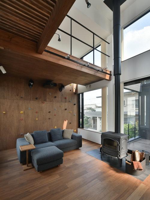 salle de s jour avec un po le bois et un manteau de chemin e en carrelage photos et id es. Black Bedroom Furniture Sets. Home Design Ideas