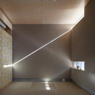 Idées déco pour une salle de séjour contemporaine avec un mur beige, un sol de tatami et aucun téléviseur.