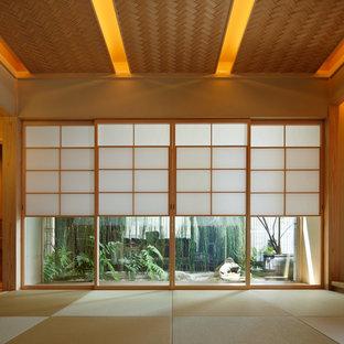 東京23区のアジアンスタイルのおしゃれなファミリールーム (畳、緑の床) の写真