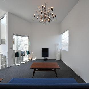名古屋のコンテンポラリースタイルのおしゃれなファミリールーム (白い壁、カーペット敷き、据え置き型テレビ) の写真