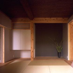 Esempio di un soggiorno etnico con pareti beige, pavimento in tatami e pavimento beige