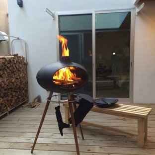 Medium sized scandi balcony in Other with a fire feature and a roof extension.